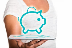 Tablet presenting piggybank as hologram Stock Images