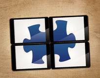 Tablet with puzzle Royalty Free Stock Images