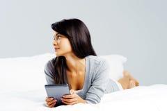 Tablet reading woman Stock Photos