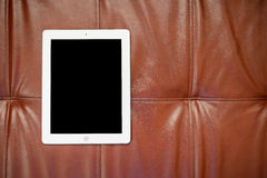 Tablet on red sofa Royalty Free Stock Photo
