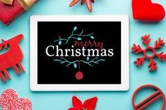 Tablet-roter Weihnachtshintergrund lizenzfreies stockfoto