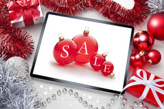 IPad Tablet Computer Sale Christmas Background. A computer ipad tablet with Christmas presents, decorations and tinsel. Can be paired with image no. 45659743 royalty free stock photo