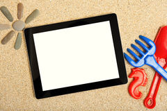 Tablet in the sand Stock Images