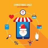 Tablet with Santa Claus on the screen and shopping web icons Royalty Free Stock Photo