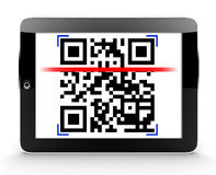 Tablet scanning a code Stock Photo