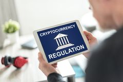 Cryptocurrency regulation concept on a tablet. Tablet screen displaying a cryptocurrency regulation concept royalty free stock photo