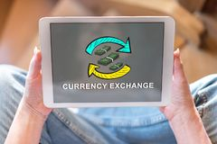 Currency exchange concept on a tablet. Tablet screen displaying a currency exchange concept Stock Photos