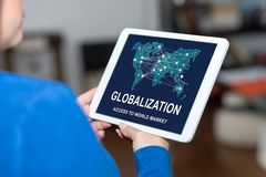 Globalization concept on a tablet. Tablet screen displaying a globalization concept stock photos