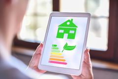 Home energy efficiency concept on a tablet royalty free stock photo
