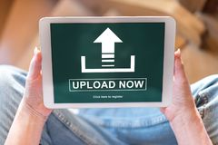 Upload concept on a tablet. Tablet screen displaying an upload concept Stock Photography