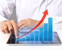 Tablet screen with graph and  hand Royalty Free Stock Photo