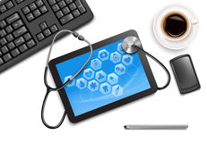 Tablet screen with medical icons and stethoscope. On the table at the doctor. Vector Royalty Free Stock Photo