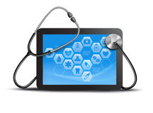 Tablet screen with medical icons and stethoscope. Stock Photo