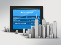 Tablet with on-screen menus and skyscrapers in the Stock Images