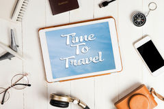 Tablet screen with time to travel Royalty Free Stock Image