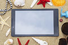 Tablet with the seashells royalty free stock images