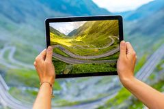 Tablet with serpentine road Stock Photo