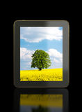 Tablet on shiny black surface Stock Images