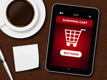 Tablet with shopping cart, cup of coffee, pen and white sheet Stock Images