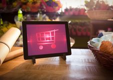 Tablet with Shopping trolley icon in Flower Shop Royalty Free Stock Photo