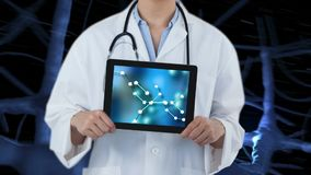 Tablet showing DNA Video. Doctor in lab coat holding tablet showing DNA against animated blue DNA backrgound stock video footage