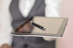 Tablet and signature. Man dressed in suit offering a tablet for an electronic signature stock photography