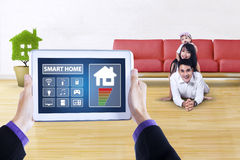 Tablet with smart home app and happy family Stock Image