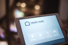 A tablet with smart home screen. A tablet with smart home control system Stock Image