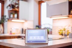 A tablet with smart home screen. A tablet with smart home control system Stock Photos