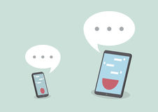 Tablet and smart phone with speech bubbles Stock Photo