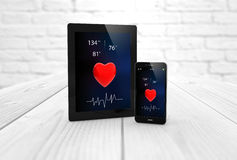 Tablet and smartphone health app Royalty Free Stock Image