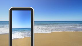 Tablet, smartphone picture of sandy seashore Stock Image