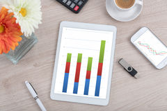 Tablet and smartphone with statistics charts Stock Photo