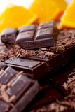 Tablet and pieces of dark chocolate. Tablet and some pieces of dark chocolate Royalty Free Stock Photos
