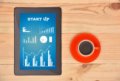 Tablet with start up chart Royalty Free Stock Photography