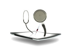 Tablet with a stethoscope Stock Photo