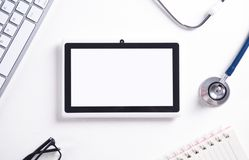 Tablet, stethoscope, keyboard, glasses and notepad. Medical concept stock photos