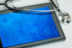 Tablet with stethoscope Stock Photos