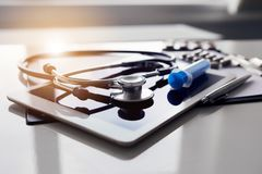 Tablet and stethoscope on white table. Medicine concept royalty free stock photography