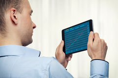 Tablet with stock market diagram Stock Photos