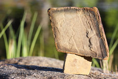 The tablet of stone. The stones stand on each other in an outdoor Royalty Free Stock Photo