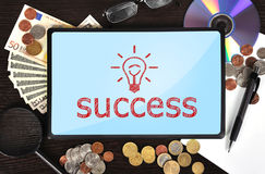 Tablet with success Royalty Free Stock Photos
