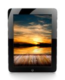 Tablet with sunset Stock Image