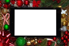 Tablet surrounded with Christmas decorations. Blank tablet surrounded with Christmas decorations Royalty Free Stock Photo