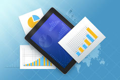 Tablet is surrounded by sheets with charts. Stock Image