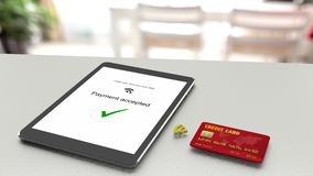 Tablet on table accepting a wireless payment from a credit card Stock Photos