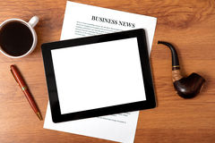 Tablet on the table of businessman Royalty Free Stock Photos