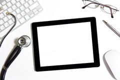 Tablet on the table of doctor Stock Image