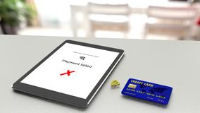 Tablet on table rejecting a wireless payment from a credit card. Tablet on table rejecting a wireless payment from a blue credit card 3D illustration Royalty Free Stock Photography