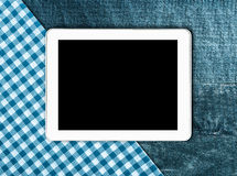 Tablet, tablecloth textile on wooden table Stock Photo